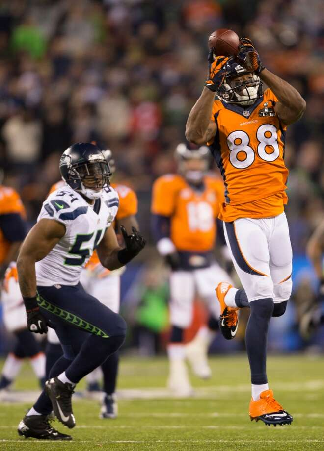 Denver's Demaryius Thomas, right, makes a catch while defended by Seattle's Bobby Wagner, left, during the third quarter of Super Bowl XLVIII Sunday, Feb. 2, 2014, at MetLife Stadium in New Jersey. (Jordan Stead, seattlepi.com) Photo: JORDAN STEAD, SEATTLEPI.COM