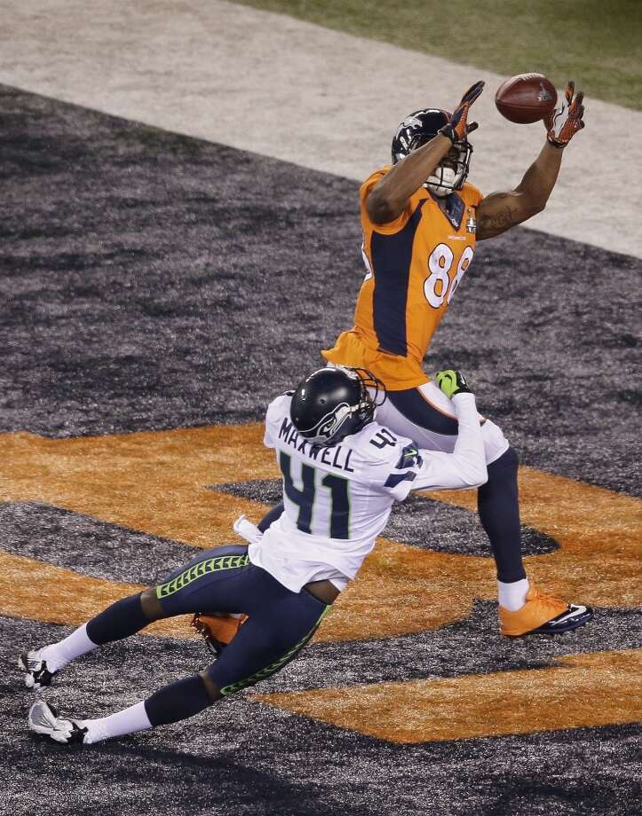Denver Broncos' Demaryius Thomas makes the catch for a touchdown against Seattle Seahawks' Byron Maxwell during the second half of the NFL Super Bowl XLVIII football game Sunday, Feb. 2, 2014, in East Rutherford, N.J. (AP Photo/Charlie Riedel) Photo: Charlie Riedel, Associated Press