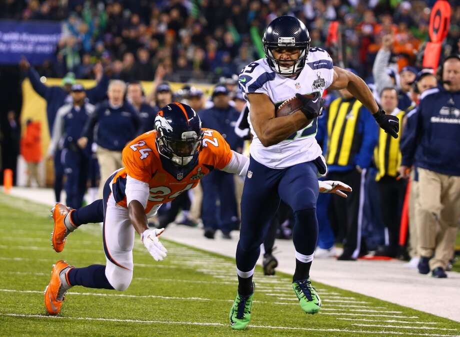 Seattle's Doug Baldwin is pursued by Denver's Champ Bailey, at Super Bowl XLVIII Sunday, Feb. 2, 2014, at MetLife Stadium in New Jersey. (Joshua Trujillo, seattlepi.com) Photo: JOSHUA TRUJILLO, SEATTLEPI.COM