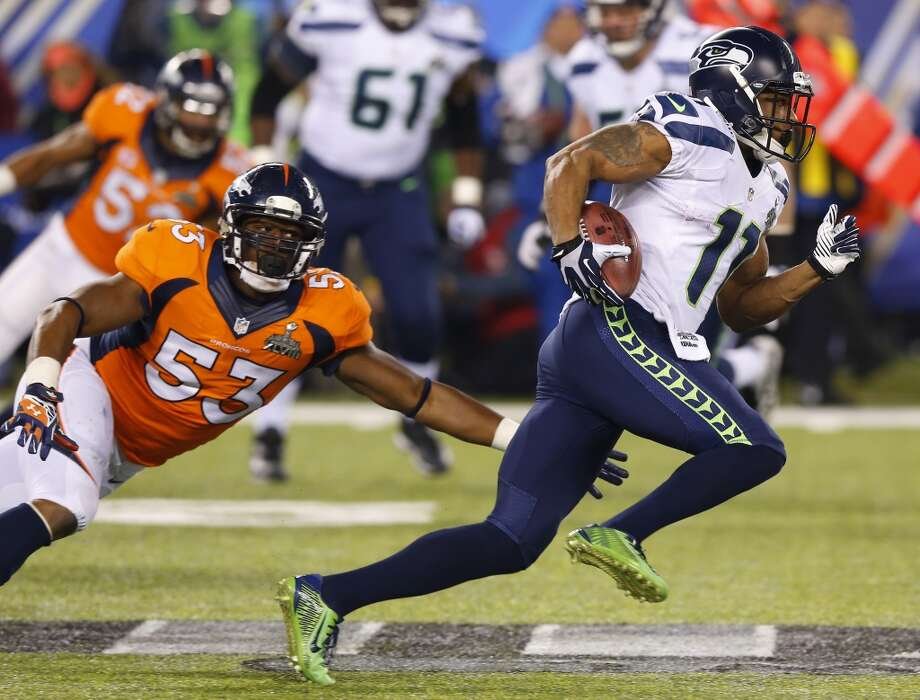 Seattle Seahawks' Percy Harvin sprints past Denver Broncos' Steven Johnson after an interception during the second half of the NFL Super Bowl XLVIII football game Sunday, Feb. 2, 2014, in East Rutherford, N.J. (AP Photo/Paul Sancya) Photo: Paul Sancya, Associated Press