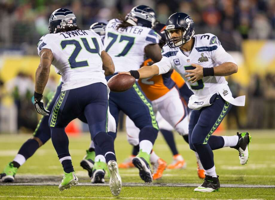 Seattle's Russell Wilson, right, hands off to Marshawn Lynch, left, during the third quarter at Super Bowl XLVIII Sunday, Feb. 2, 2014, at MetLife Stadium in New Jersey. (Jordan Stead, seattlepi.com) Photo: JORDAN STEAD, SEATTLEPI.COM