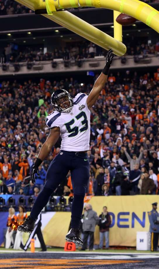 Seattle's Malcolm Smith scores a touchdown on a interception in the second quarter at Super Bowl XLVIII Sunday, Feb. 2, 2014, at MetLife Stadium in New Jersey. (Joshua Trujillo, seattlepi.com) Photo: JOSHUA TRUJILLO, SEATTLEPI.COM