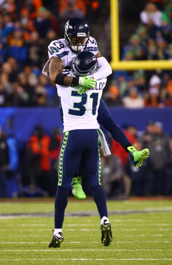 Seattle's Kam Chancellor, #31, and Earl Thomas, #29, celebrate after a tackle at Super Bowl XLVIII Sunday, Feb. 2, 2014, at MetLife Stadium in New Jersey. (Joshua Trujillo, seattlepi.com) Photo: JOSHUA TRUJILLO, SEATTLEPI.COM