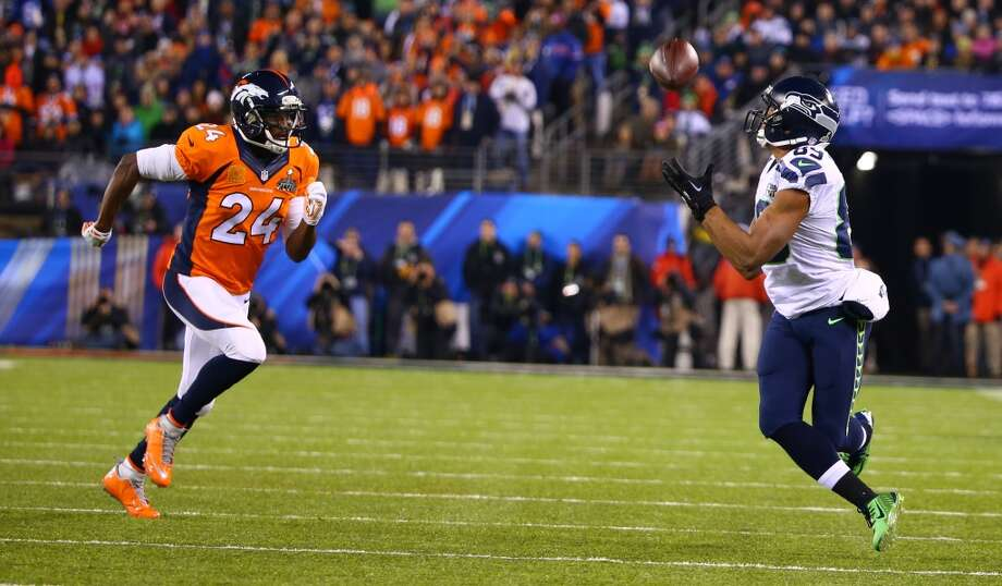 Seattle's Doug Baldwin hauls in a pass while covered by Denver's Champ Bailey, at Super Bowl XLVIII Sunday, Feb. 2, 2014, at MetLife Stadium in New Jersey. (Joshua Trujillo, seattlepi.com) Photo: JOSHUA TRUJILLO, SEATTLEPI.COM