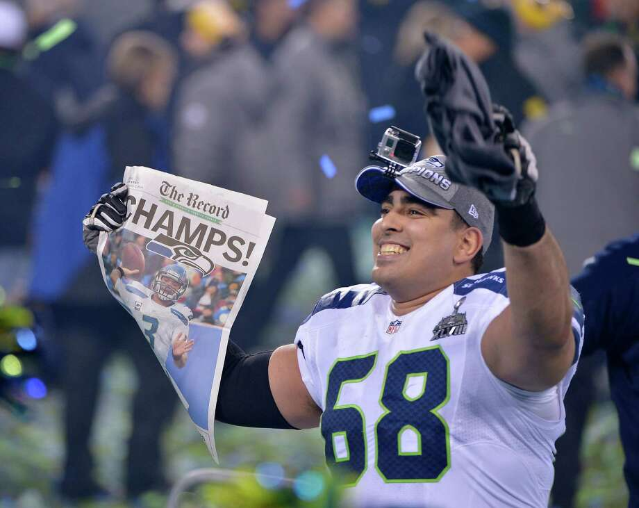 Seattle Seahawks' Breno Giacomini (68) celebrates after the NFL Super Bowl XLVIII football game against the Denver Broncos Sunday, Feb. 2, 2014, in East Rutherford, N.J. The Seahawks won 43-8. (AP Photo/Bill Kostroun) Photo: Bill Kostroun, Associated Press / FR51951 AP