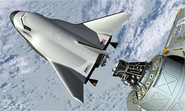 An artist's rendering shows Sierra Nevada Corp.'s Dream Chaser docking with the International Space Station. The company is competing with SpaceX and Boeing for NASA funds.