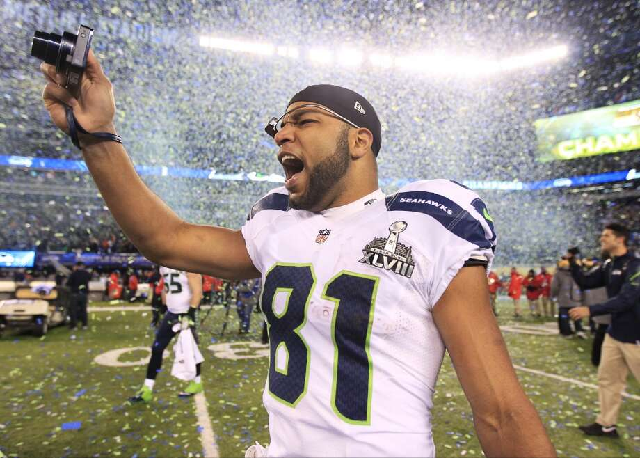 Seattle Seahawks' Golden Tate celebrates after the NFL Super Bowl XLVIII football game against the Denver Broncos Sunday, Feb. 2, 2014, in East Rutherford, N.J. The Seahawks won 43-8. (AP Photo/Jeff Roberson) Photo: Jeff Roberson, Associated Press