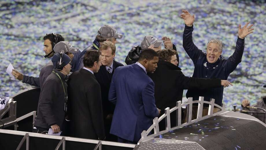 Seattle Seahawks head coach Pete Carroll, right, celebrates after the NFL Super Bowl XLVIII football game against the Denver Broncos, Sunday, Feb. 2, 2014, in East Rutherford, N.J. The Seahawks won 43-8. (AP Photo/Charlie Riedel) Photo: Charlie Riedel, Associated Press