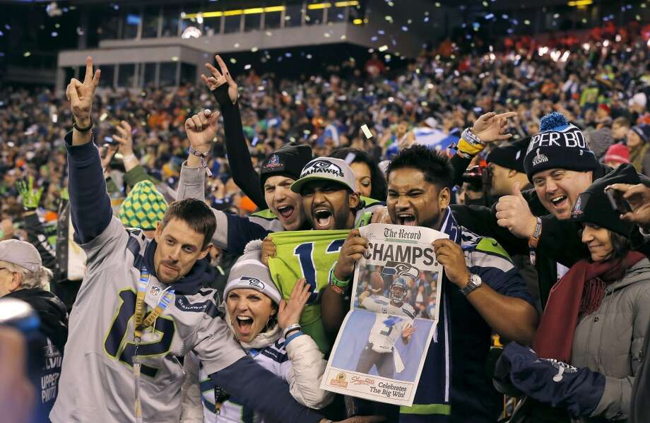 Seattle Seahawks fans celebrate after the NFL Super Bowl XLVIII football game against the Denver Broncos Sunday, Feb. 2, 2014, in East Rutherford, N.J. The Seahawks won 43-8. (AP Photo/Matt York) Photo: Matt York, Associated Press