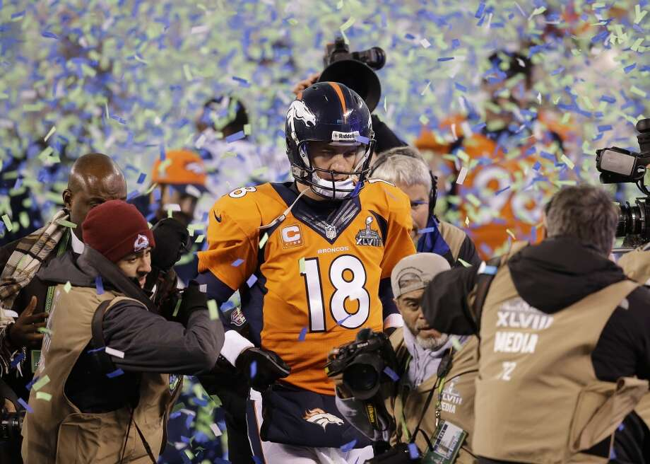 Denver Broncos quarterback Peyton Manning walks off the field after the Broncos lost to the Seattle Seahawks in the NFL Super Bowl XLVIII football game Sunday, Feb. 2, 2014, in East Rutherford, N.J. The Seahawks won 43-8. (AP Photo/Chris O'Meara) Photo: Chris O'Meara, Associated Press