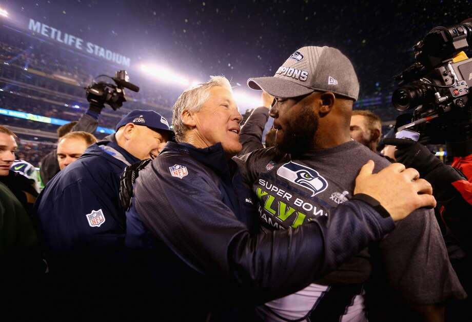 Head coach Pete Carroll of the Seattle Seahawks celebrates with players after Super Bowl XLVIII at MetLife Stadium on February 2, 2014 in East Rutherford, New Jersey.The Seahawks beat the Broncos 43-8.  (Photo by Elsa/Getty Images) Photo: Elsa, Getty Images