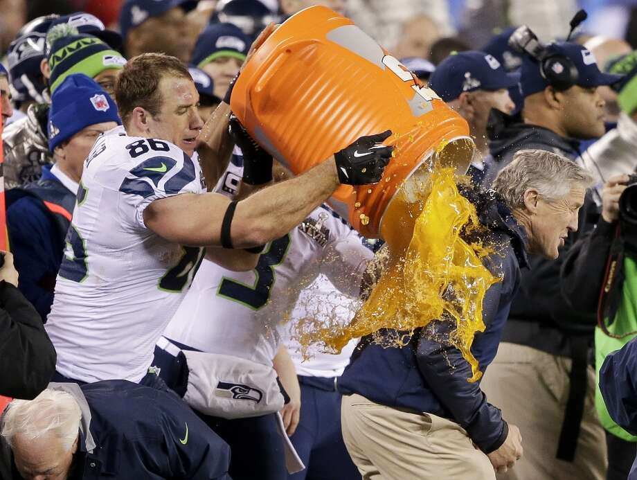 Seattle Seahawks' Zach Miller dumps Gatorade on Seattle Seahawks head coach Pete Carroll during the second half of the NFL Super Bowl XLVIII football game Sunday, Feb. 2, 2014, in East Rutherford, N.J. The Seahawks won 43-8. (AP Photo/Gregory Bull) Photo: Gregory Bull, Associated Press
