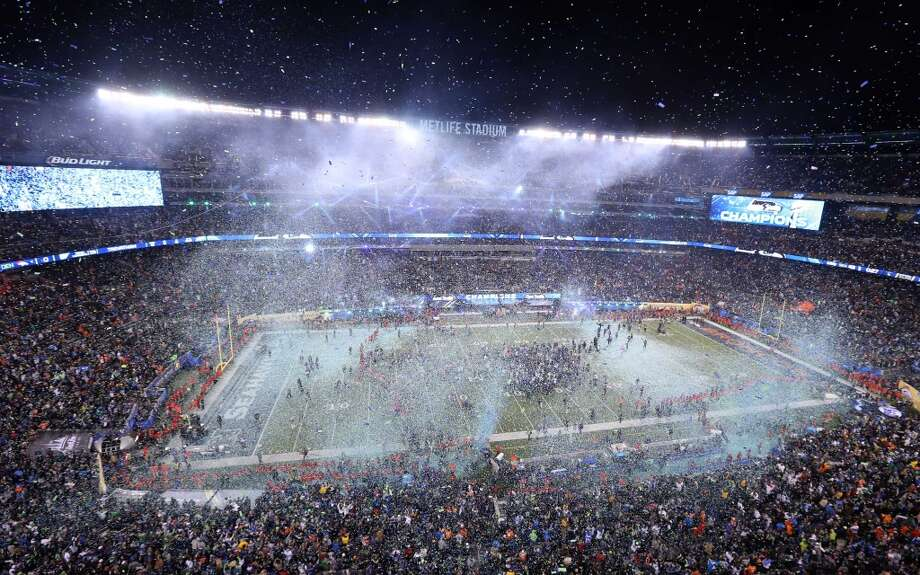 A general view as blue and green confetti is shot in the air after Super Bowl XLVIII between the Seattle Seahawks and the Denver Broncos at MetLife Stadium.  Mandatory Credit: Anthony Gruppuso-USA TODAY Sports Photo: Anthony Gruppuso, Reuters