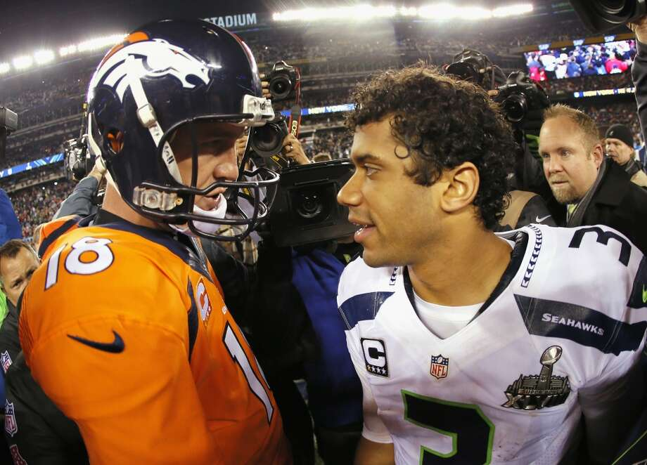 Quarterback Peyton Manning #18 of the Denver Broncos congratulates quarterback Russell Wilson #3 of the Seattle Seahawks on their 43-8 win during Super Bowl XLVIII at MetLife Stadium on February 2, 2014 in East Rutherford, New Jersey.  (Photo by Kevin C. Cox/Getty Images) Photo: Kevin C. Cox, Getty Images
