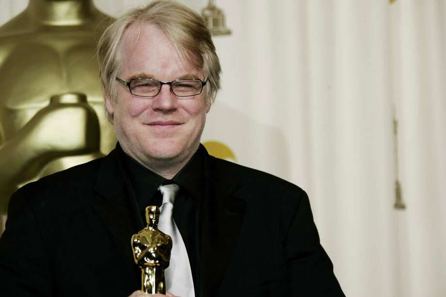 """FILE - In a Sunday, March 5, 2006, file photo, actor Philip Seymour Hoffman poses with the Oscar he won for best actor for his work in """"Capote"""" at the 78th Academy Awards, in Los Angeles.   Police say  Hoffman has been found dead in his  apartment. Sunday Feb. 2014.  HE WAS 46.(AP Photo/Kevork Djansezian, File) ORG XMIT: NY118 Photo: KEVORK DJANSEZIAN / AP"""