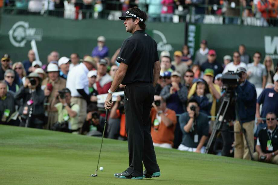 A disbelieving Bubba Watson is stunned at missing a 5-foot par putt that would have forced a playoff, instead allowing Kevin Stadler to win the Phoenix Open by a stroke. Photo: Robert Laberge, Stringer / 2014 Getty Images