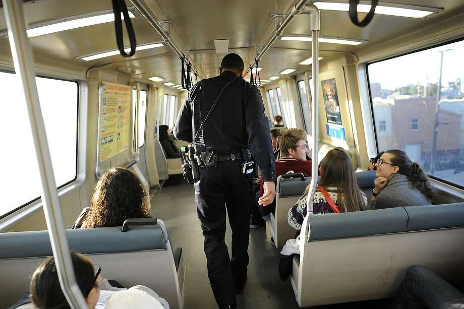 In this file photo, BART police Sgt. Jason Scott rides a train in Oakland. BART trains were delayed this morning in Oakland and San Francisco because of police activity. Photo: Michael Short, Special To The Chronicle