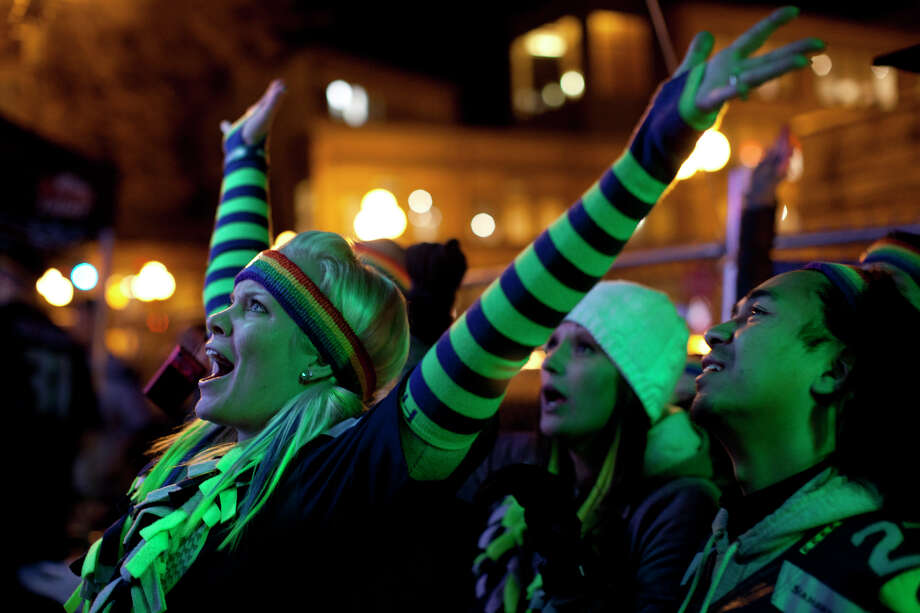 Fans cheer at Fuel in Pioneer Square after a touchdown against the Denver Broncos in Super Bowl XLVIII on Sunday in Seattle. Photo: CHRIS WILSON, (Chris Wilson,  Seattlepi.com)