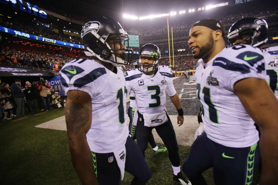Seattle's Percy Harvin, left, celebrates a touchdown with teammates Russell Wilson, center, and Golden Tate, right, in the third quarter of Super Bowl XLVIII Sunday, Feb. 2, 2014, at MetLife Stadium in New Jersey. (Joshua Trujillo, seattlepi.com) Photo: SEATTLEPI.COM