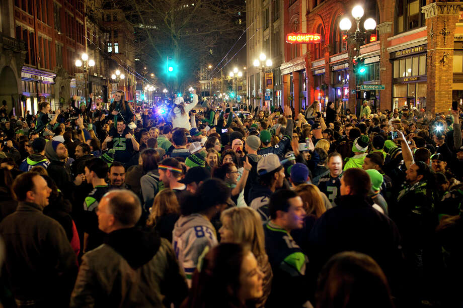 Fans celebrate on First Avenue in Pioneer Square after the Seattle 