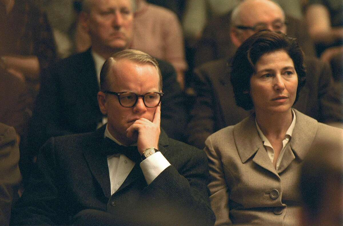 Actor Phillip Seymour Hoffman (L) and actress Catherine Keener are shown in a scene from