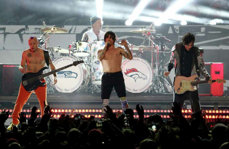 The Super Bowl XLVIII Halftime Show caused a 'super' controversy for the Red Hot Chili Peppers. In a nutshell: Flea fessed up and said the only thing live about their act was Anthony Kiedis' vocals. The band's defense? They say the Super Bowl big wigs didn't want to deal with the technical and audio problems that could arise, since the RHCP were only playing one song. Flea went on to say playing at the Super Bowl was a once-in-a-lifetime opportunity, so they went ahead and did it. But not before going on stage with their guitars unplugged.They're not the only ones whose performances landed them in hot water. Keep clicking to see other stars who were entangled in lip-syncing controversy.  Photo: Larry Busacca, Getty Images / 2014 Getty Images