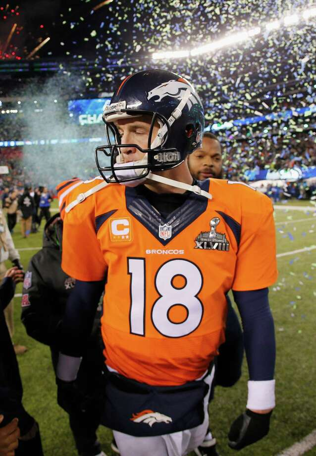 EAST RUTHERFORD, NJ - FEBRUARY 02:  Quarterback Peyton Manning #18 of the Denver Broncos walks off the field after their 43-8 loss to the Seattle Seahawks during Super Bowl XLVIII at MetLife Stadium on February 2, 2014 in East Rutherford, New Jersey.  (Photo by Kevin C. Cox/Getty Images) ORG XMIT: 464680907 Photo: Kevin C. Cox / 2014 Getty Images