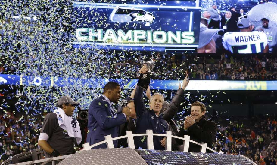 Seahawks 43, Broncos 8 Seahawks head coach Pete Carroll holds the Vince Lombardi Trophy. Photo: Ted S. Warren, Associated Press