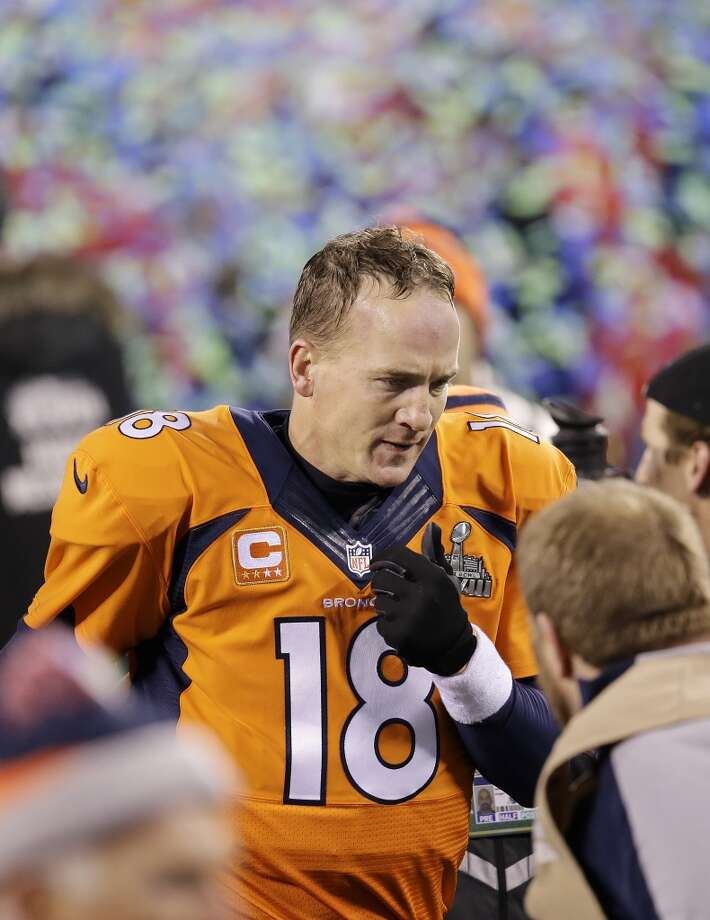 Peyton Manning walks off the field. Photo: Chris O'Meara, Associated Press