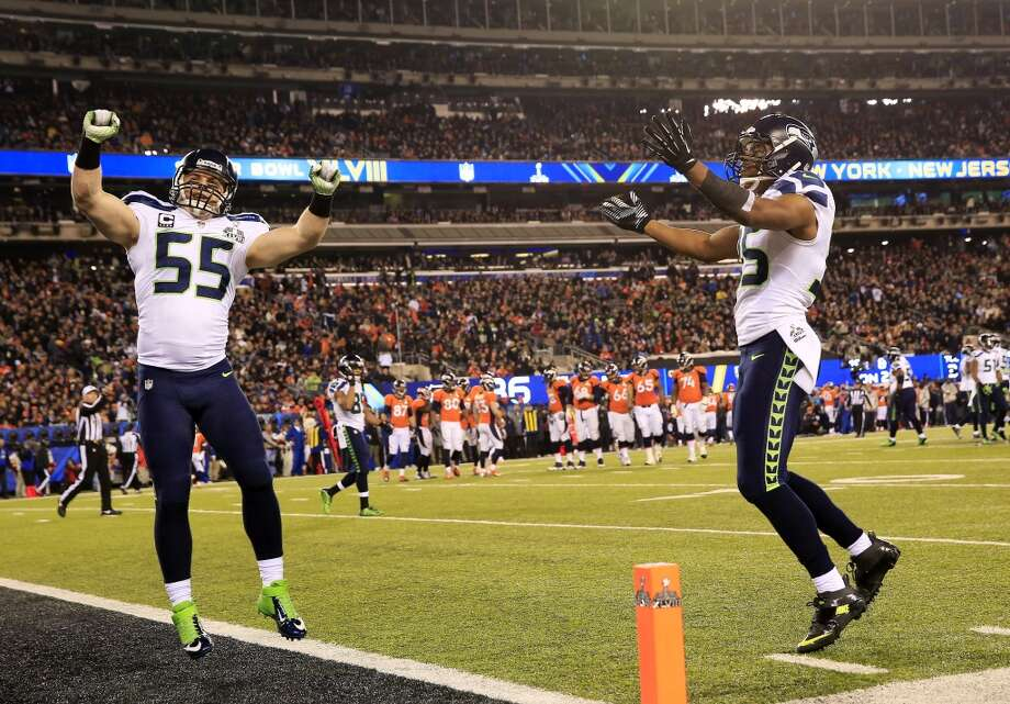 Linebacker Heath Farwell #55 of the Seahawks celebrates with wide receiver Jermaine Kearse #15. Photo: Jamie Squire, Getty Images