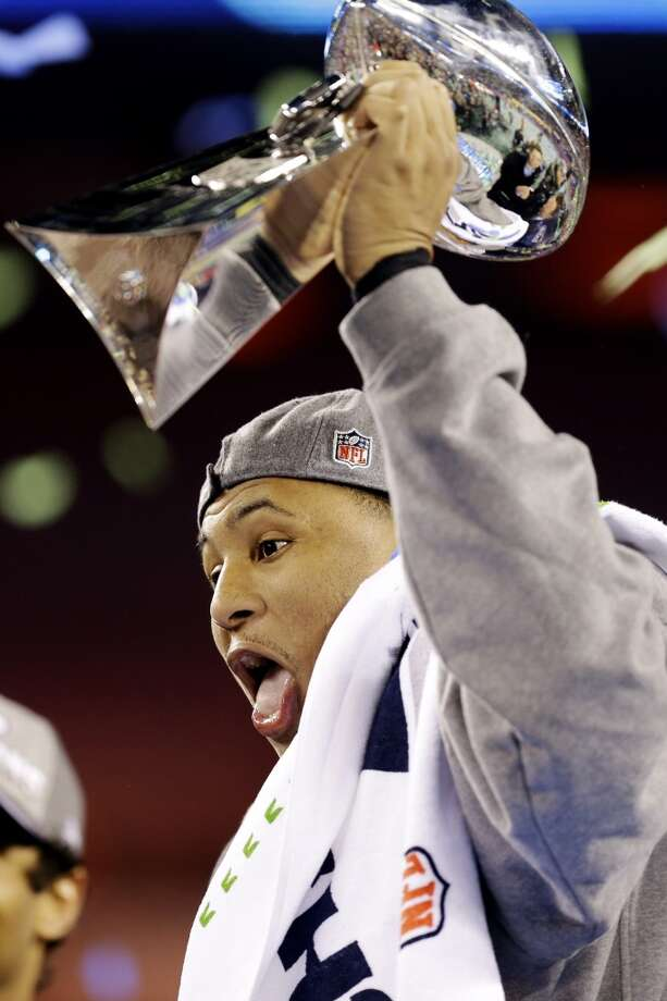 Most Valuable Player, Malcolm Smith, holds the the Vince Lombardi Trophy. Photo: Ben Margot, Associated Press