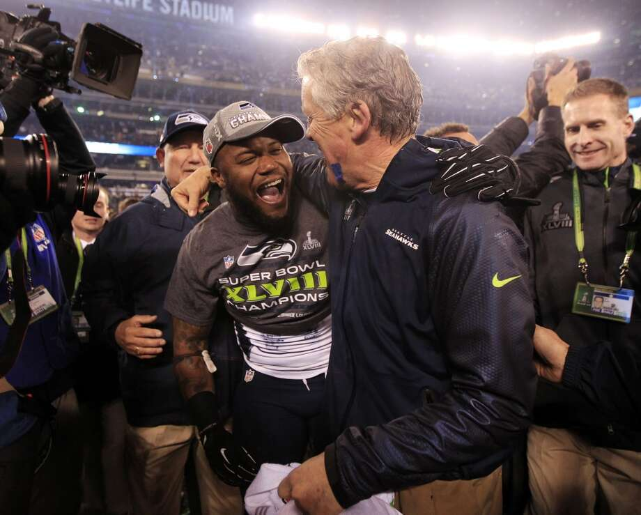 Seahawks head coach Pete Carroll, right, celebrates. Photo: Jeff Roberson, Associated Press