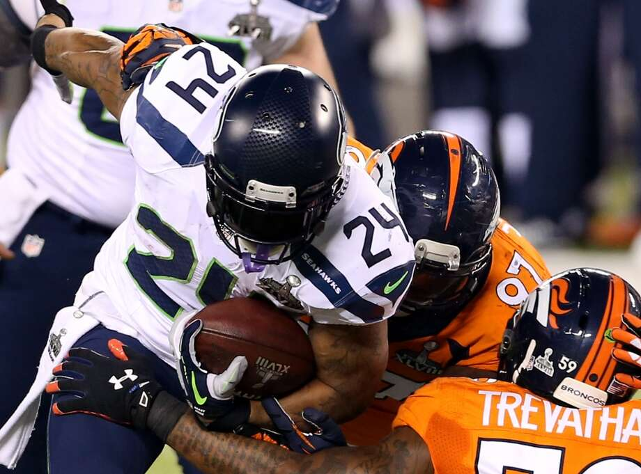 Running back Marshawn Lynch #24 of the Seahawks   runs the ball. Photo: Christian Petersen, Getty Images
