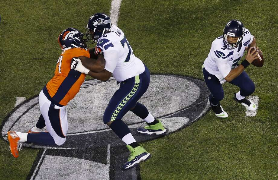 Quarterback Russell Wilson #3 of the Seahawks looks to pass. Photo: Jeff Zelevansky, Getty Images
