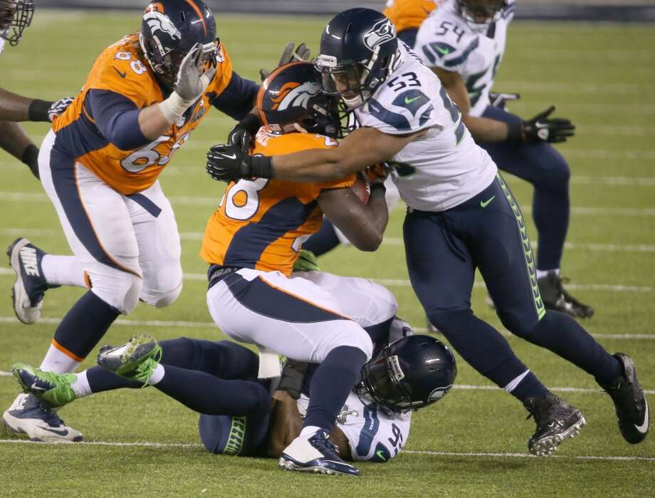 Malcolm Smith (53) of the Seahawks stops Montee Ball (28) of the Broncos late in the second half. Photo: Brian Branch Price, McClatchy-Tribune News Service