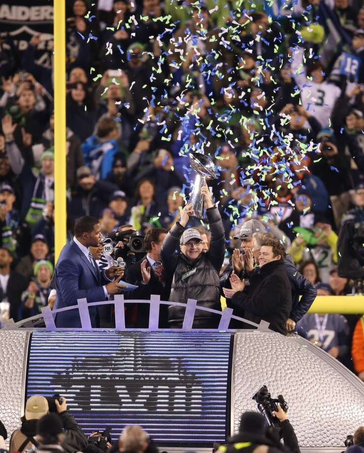 Paul Allen, owner of the Seahawks, celebrates with the Lombardi trophy. Photo: Brian Branch Price, McClatchy-Tribune News Service