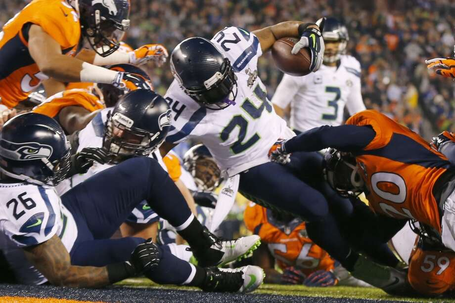 4. The Seahawks won with their brand of footballPete Carroll's Hawks have their own, distinct style of football: play suffocating defense with a punishing, run-first offense and excellent special teams while limiting mistakes.That's exactly what they did Sunday night.After averaging 120 rushing yards per game in the playoffs, Knowshon Moreno and the Broncos were able to muster just 18 on the ground against the Seahawks. The Hawks defense forced four turnovers, par for the course for a team that led the league in takeaways this season.On offense, Russell Wilson was calm and collected on the biggest stage of his career, completing 72 percent of his passes, including scoring strikes to Jermaine Kearse and Doug Baldwin. Though Marshawn Lynch had a quiet game on the ground, the team still finished with 135 yards thanks to contributions from Wilson, Percy Harvin and Robert Turbin. Most importantly, the Hawks didn't commit any turnovers that could have allowed Denver to get back into the game.The Seattle special teams were phenomenal. Harvin's touchdown return was the obvious highlight, but kicker Steven Hauschka was perfect and punter Jon Ryan effective in limited action.It wasn't all pretty — the Hawks committed 10 penalties for 104 yards — but even that was part of the team's identity after leading the league this season. And the team served a heaping helping of crow to those who claimed all year long that Seattle would have a hard time winning the big game when committing so many infractions — yours included. Photo: Paul Sancya, ASSOCIATED PRESS