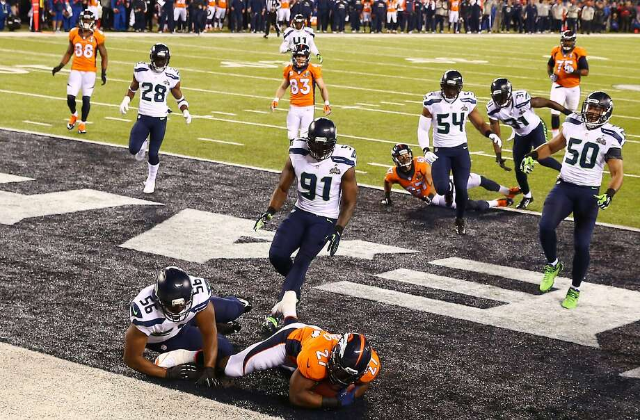 Denver running back Knowshon Moreno (center at bottom) falls on the ball in the end zone on the first play Sunday, forced to concede a safety after Manny Ramirez's snap sailed past Peyton Manning. Photo: Tom Pennington, Getty Images
