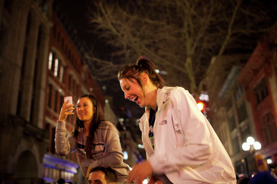 Fans celebrate on First Avenue in Pioneer Square after the Seattle Seahawks 43-8 win agains the Denver Broncos in Super Bowl XLVIII on Sunday, February 2, 2014 in Seattle. Photo: CHRIS WILSON, (Chris Wilson,  Seattlepi.com)