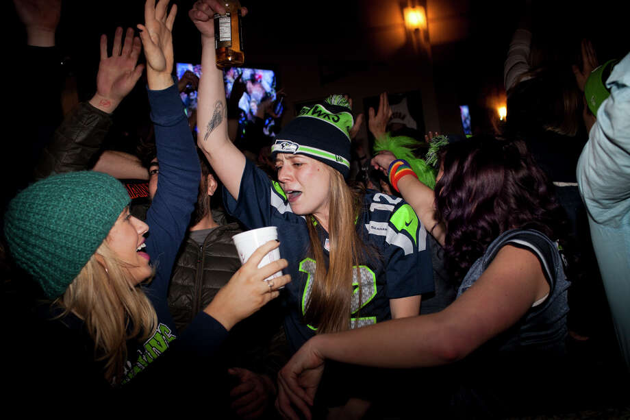 Fans celebrate at Fuel bar Pioneer Square after the Seattle Seahawks 43-8 win agains the Denver Broncos in Super Bowl XLVIII on Sunday, February 2, 2014 in Seattle. Photo: CHRIS WILSON, (Chris Wilson,  Seattlepi.com)