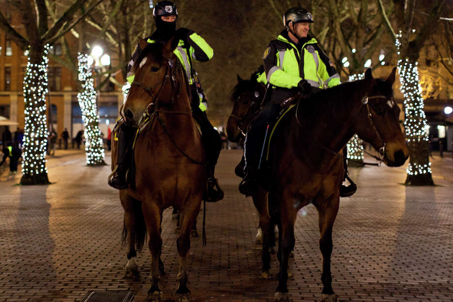 Mounted police prepare in Pioneer Square before the Seattle Seahawks 43-8 win agains the Denver Broncos in Super Bowl XLVIII on Sunday, February 2, 2014 in Seattle. Photo: CHRIS WILSON, (Chris Wilson,  Seattlepi.com)