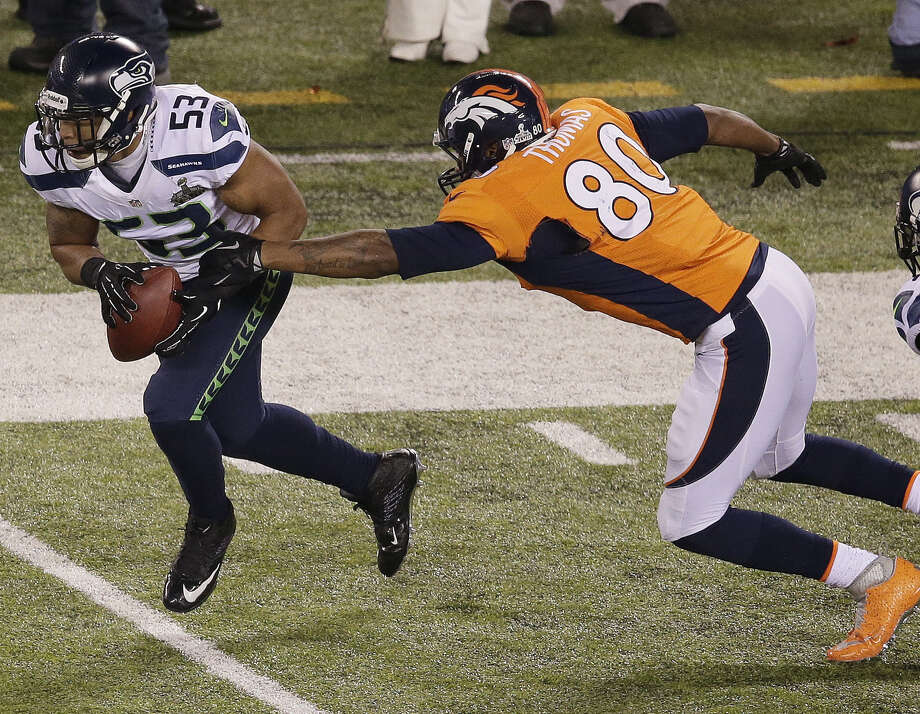 Seattle's Malcolm Smith (left), recovering a fumble as Denver's Julius Thomas gives chase, is the third linebacker to be named Super Bowl MVP. Dallas' Chuck Howley (1971) is another. Photo: Charlie Riedel, Associated Press / AP