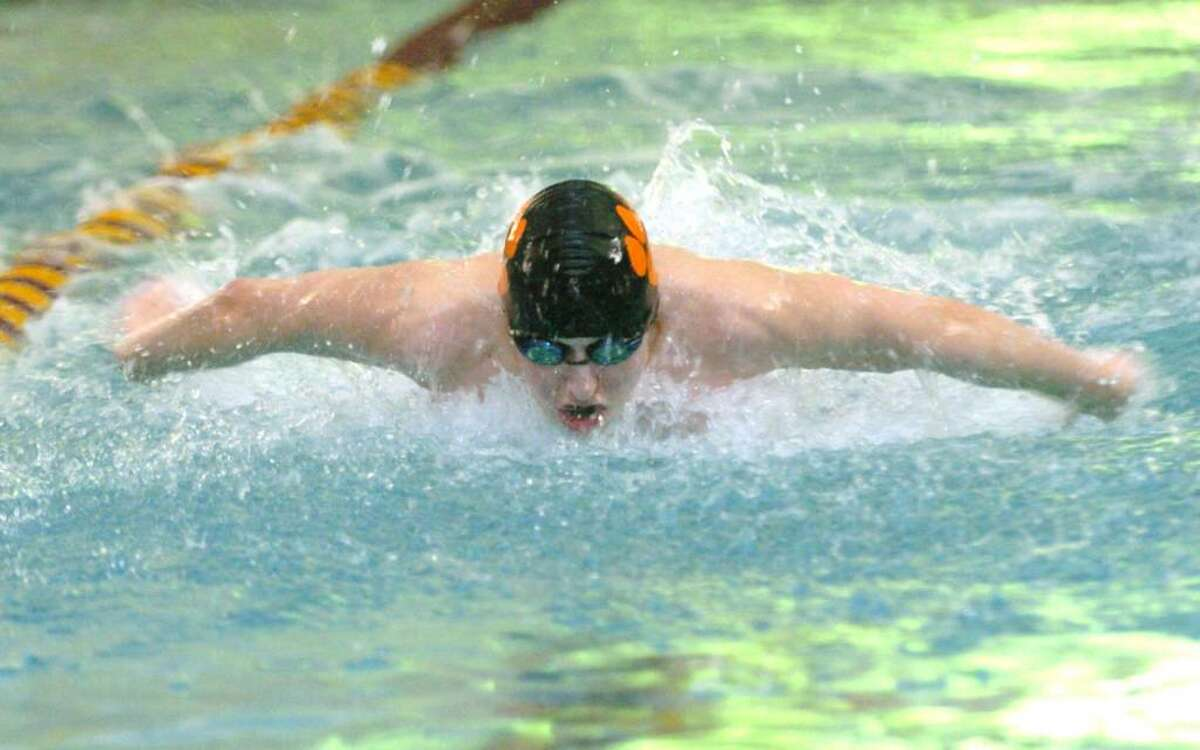 Ridgefield's Grayson Smith, competes in the 200 Medley Relay during the swim meet against Wilton at the YMCA in Wilton, CT, Friday, Feb. 5, 2010.