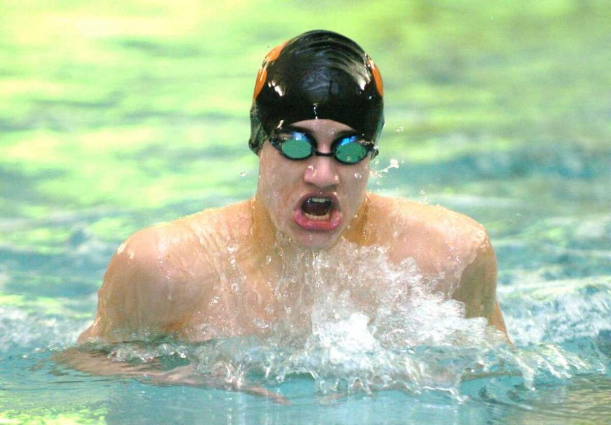 Ridgefield's Tom Szlagyi, competes in the 200 Medley Relay during the swim meet against Wilton at the YMCA in Wilton, CT, Friday, Feb. 5, 2010.