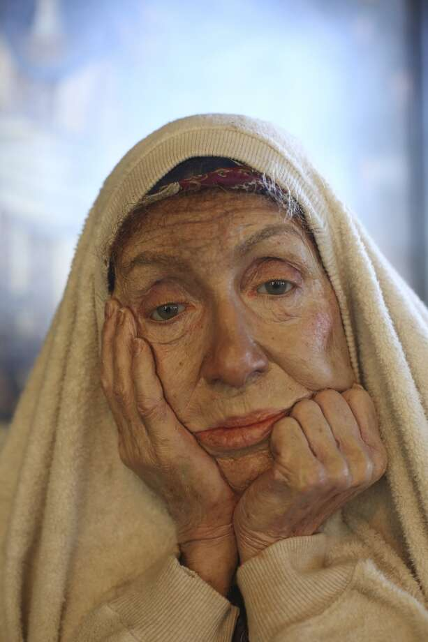 A life-like figure of a homeless woman created by artist Marc Sijan is on display at The Pritikin Museum in San Francisco. Photo: The Chronicle