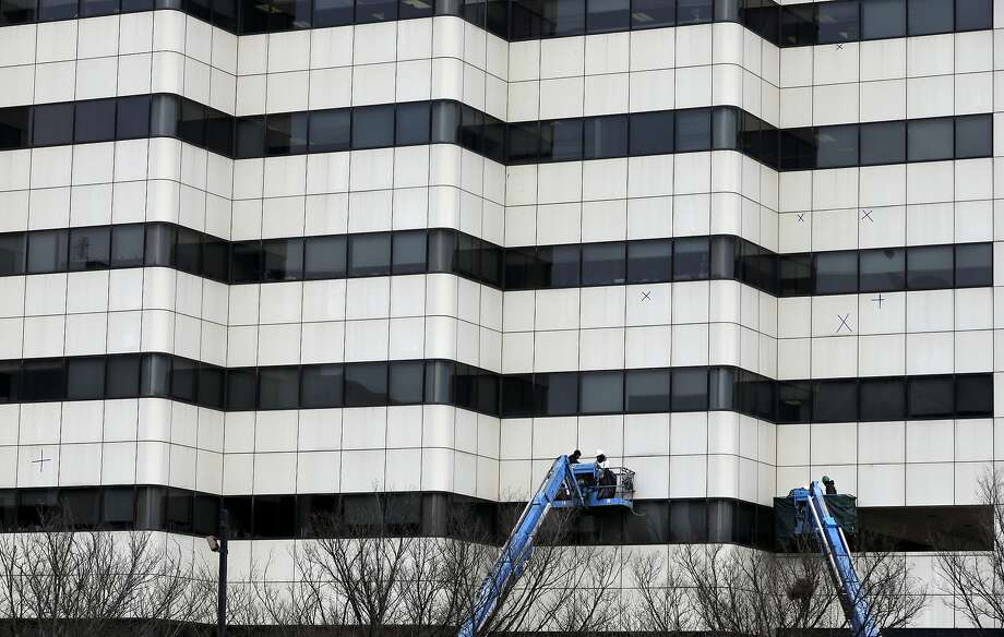 In this Monday, Jan. 20, 2014 photo, workers use bucket lifts as they work on an office building, in Trenton, N.J.  The Commerce Department releases construction spending for December on Monday, Feb. 3, 2014. (AP Photo/Mel Evans) Photo: Mel Evans, Associated Press