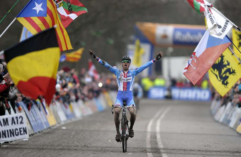 The Czech Republic's Zdenek Stybar celebrates at the finishing line after winning the men's event at the 2014 UCI Cyclo-Cross World Championships in Hoogerheide February 2, 2014.  REUTERS/Laurent Dubrule (NETHERLANDS - Tags: SPORT CYCLING TPX IMAGES OF THE DAY) Photo: Laurent Dubrule, Reuters