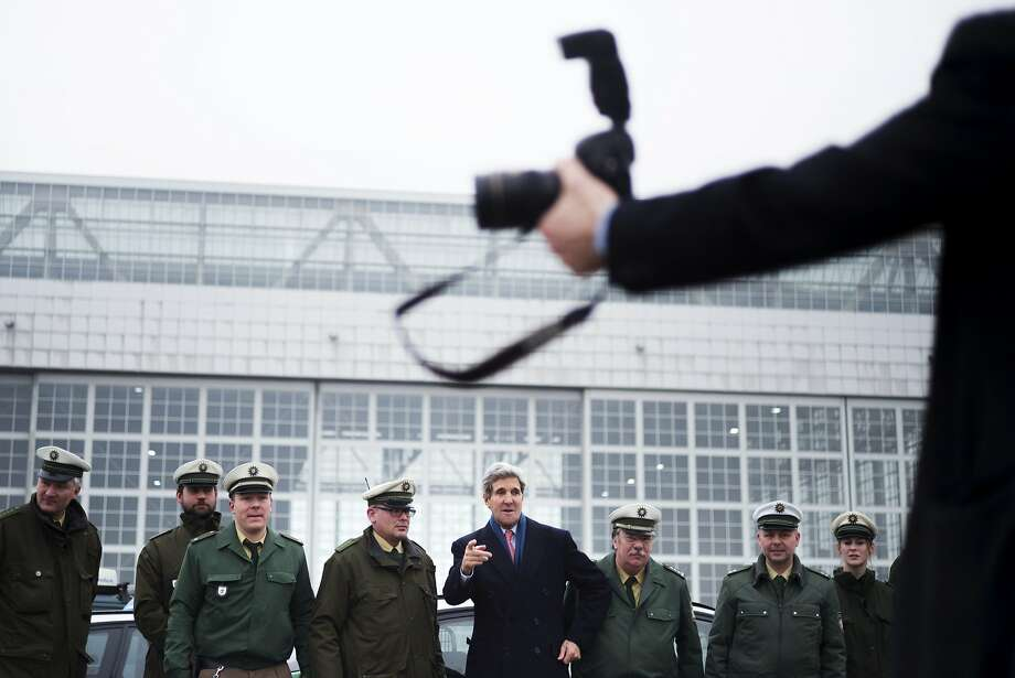 U.S. Secretary of State John Kerry (C) poses with German policemen before boarding his plane at Franz-Josef-Strauss Airport in Munich, southern Germany, February 2, 2014. Kerry was in the Bavarian capital to attend the Munich Security Conference. REUTERS/Brendan Smialowski/Pool (GERMANY - Tags: POLITICS TPX IMAGES OF THE DAY) Photo: Pool, Reuters