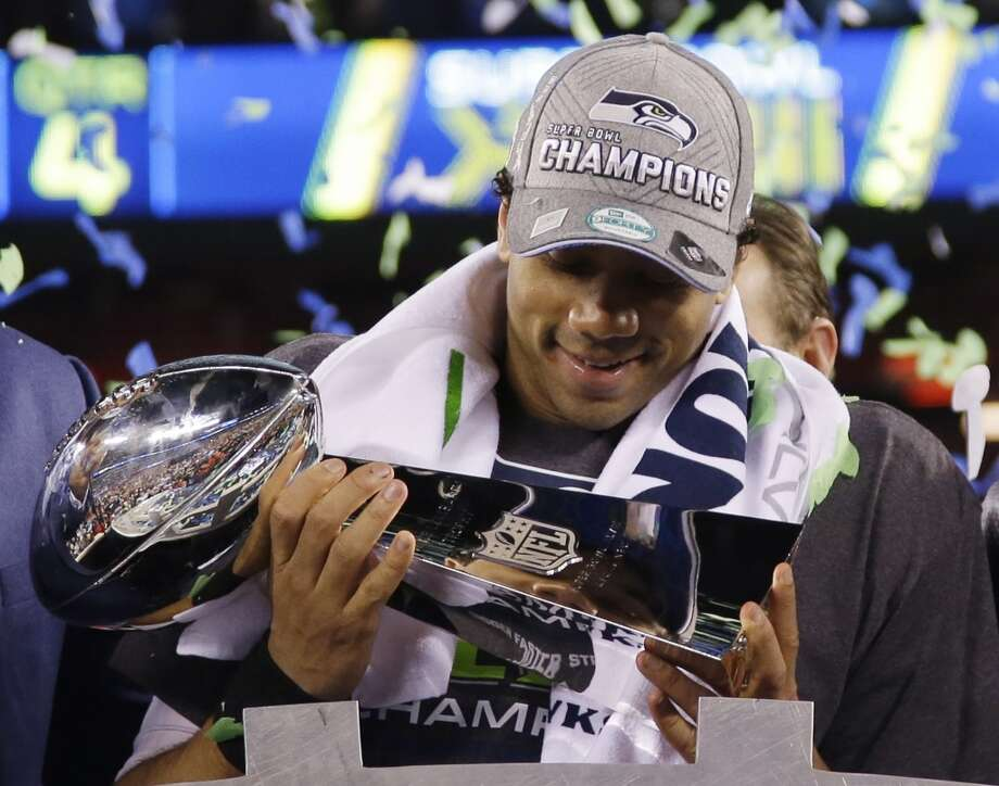 "Quarterback Russell Wilson  ""To be the second African-American (quarterback) to win the Super Bowl, that's history right there. There are so many guys before me who have tried to change the game and done a great job at it. God's so good. It doesn't matter what you look like. It doesn't matter if you're black, white, Latino, Asian. It doesn't matter if you're 5-foot-11. It doesn't matter how many people tell you no. It's the heart that you have. That's what I try to prove every day."" Photo: Matt Slocum, ASSOCIATED PRESS"