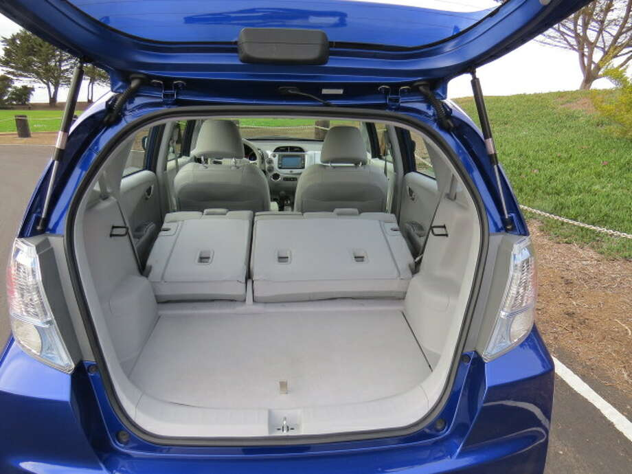 With the rear seat backs folded, there's enough room for groceries and the luggage for a long trip.